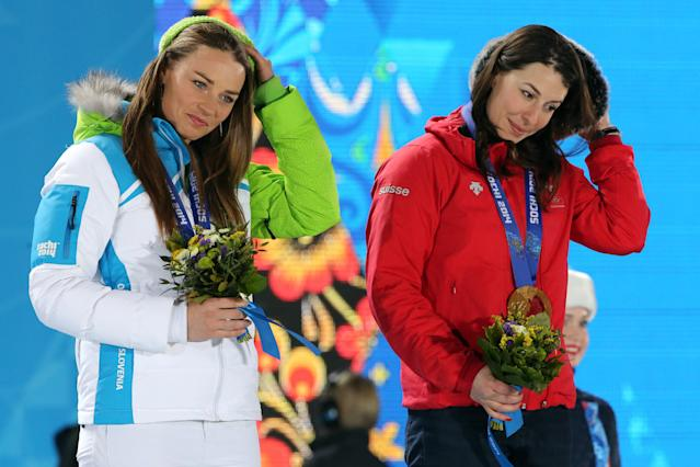 Gold medalists Switzerland's Dominique Gisin (R) and Slovenia's Tina Maze pose on the podium during the Women's Alpine Skiing Downhill Medal Ceremony at the Sochi medals plaza on February 12, 2014.(Getty Images)