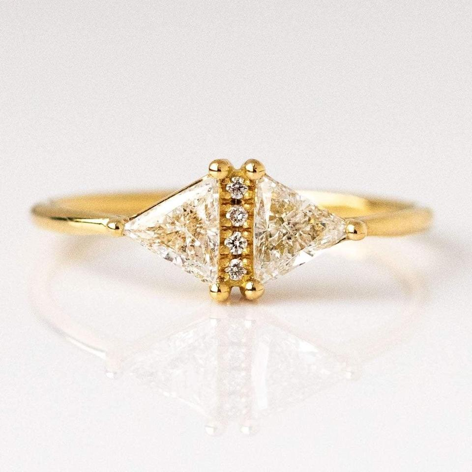 """<p>The sparkling row of diamonds in the center of this <a href=""""https://www.popsugar.com/buy/Art-Deco-Diamond-Triangle-Ring-532221?p_name=Art%20Deco%20Diamond%20Triangle%20Ring&retailer=localeclectic.com&pid=532221&price=2%2C800&evar1=fab%3Aus&evar9=7954958&evar98=https%3A%2F%2Fwww.popsugar.com%2Fphoto-gallery%2F7954958%2Fimage%2F47021269%2FArt-Deco-Diamond-Triangle-Ring&list1=shopping%2Cwedding%2Cjewelry%2Crings%2Cbride%2Cengagement%20rings%2Cfashion%20shopping&prop13=api&pdata=1"""" rel=""""nofollow noopener"""" class=""""link rapid-noclick-resp"""" target=""""_blank"""" data-ylk=""""slk:Art Deco Diamond Triangle Ring"""">Art Deco Diamond Triangle Ring</a> ($2,800) is breathtaking. </p>"""