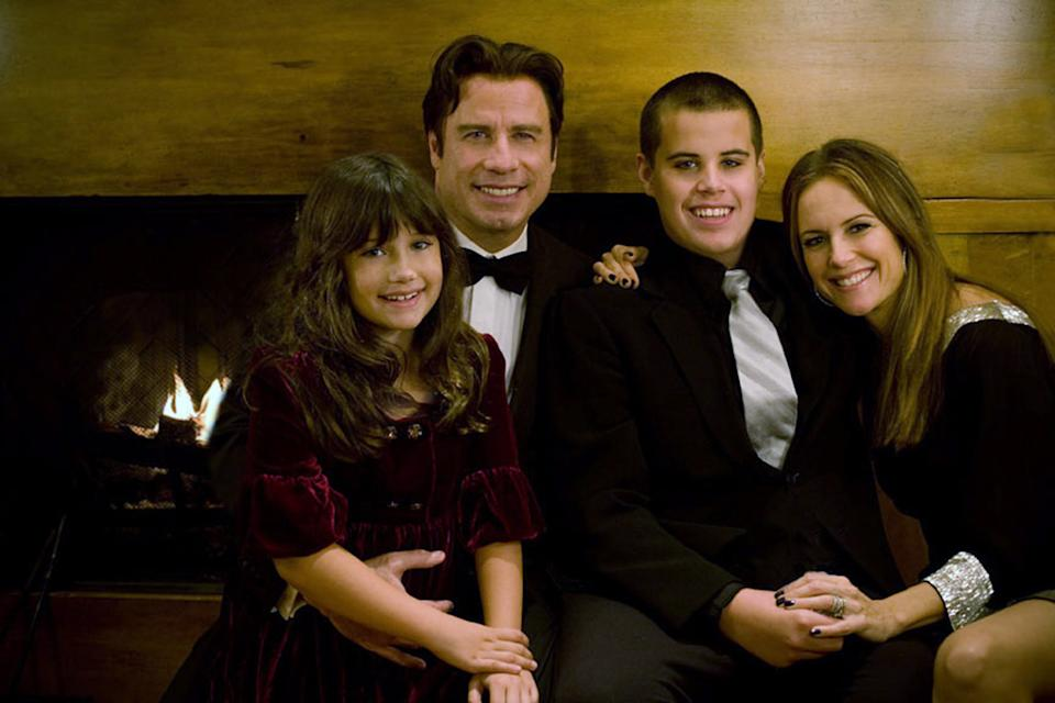 John Travolta (2nd L), his wife Kelly Preston (R) and their children Jett (2nd R) and Ella. (Photo by Rogers and Cowan via Getty Images)
