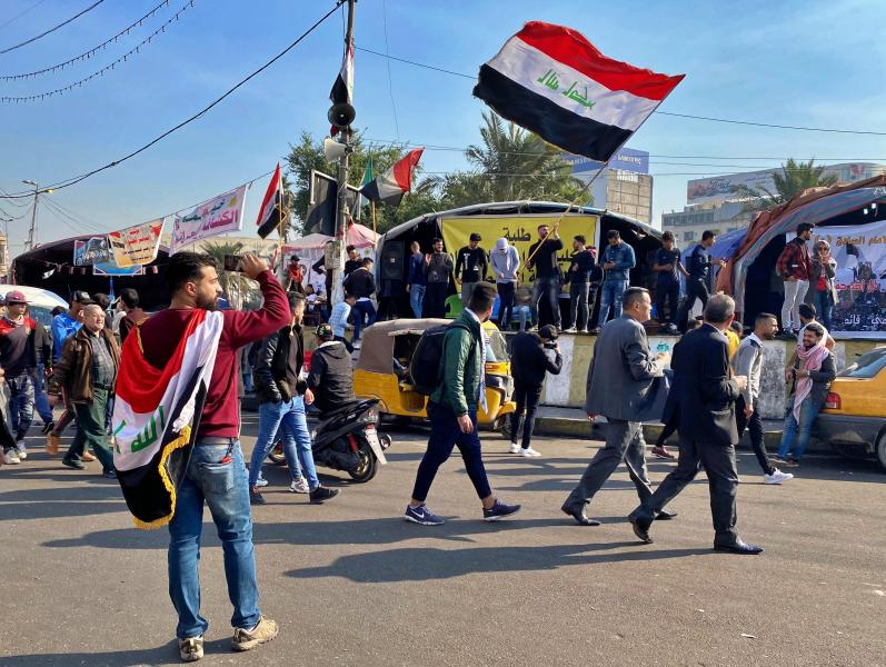 Anti-government protesters gather at Tahrir Square in Baghdad, Iraq, Sunday, Dec. 22, 2019. Thousands of protesters poured into the streets of Baghdad and Iraq's southern provinces on Sunday, rejecting the nomination of what some call an Iran-backed candidate for the prime minister's post. The demonstrations came as a midnight deadline loomed without a solution being reached to name an interim premier. (AP Photo/Khalid Mohammed)