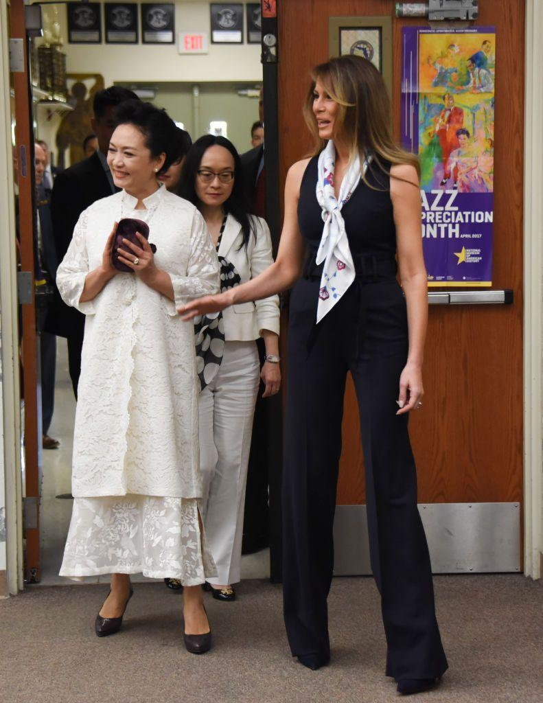 <p>The First Lady and Peng Liyuan, wife of the Chinese President, toured four classes at Bak Middle School of the Arts. Melania Trump took on a stylish look with her dark navy pantsuit and floral scarf.</p>