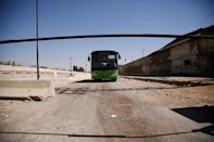 An empty bus that was supposed to evacuate people drives near the entrance of the Waer district in the central Syrian city of Homs, Syria September 19, 2016. REUTERS/Omar Sanadiki