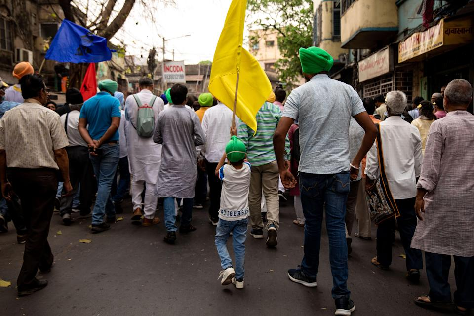 Farmer leaders march in the rally while protesting against the farm laws