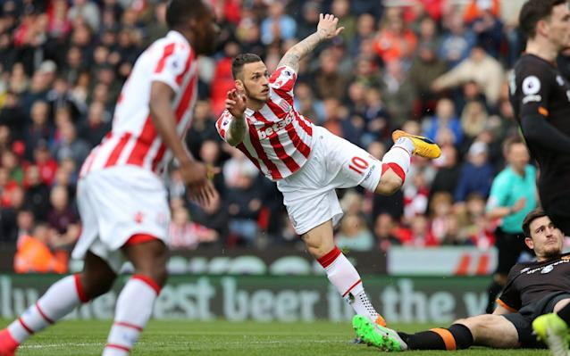 <span>Marko Arnautovic turns the ball past Hull's keeper to put the home side 1-0 up</span> <span>Credit: Barrington Coombs/PA </span>