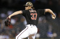 Arizona Diamondbacks' Kevin Ginkel delivers a pitch against the Washington Nationals during the sixth inning of a baseball game Friday, May 14, 2021, in Phoenix. (AP Photo/Darryl Webb)