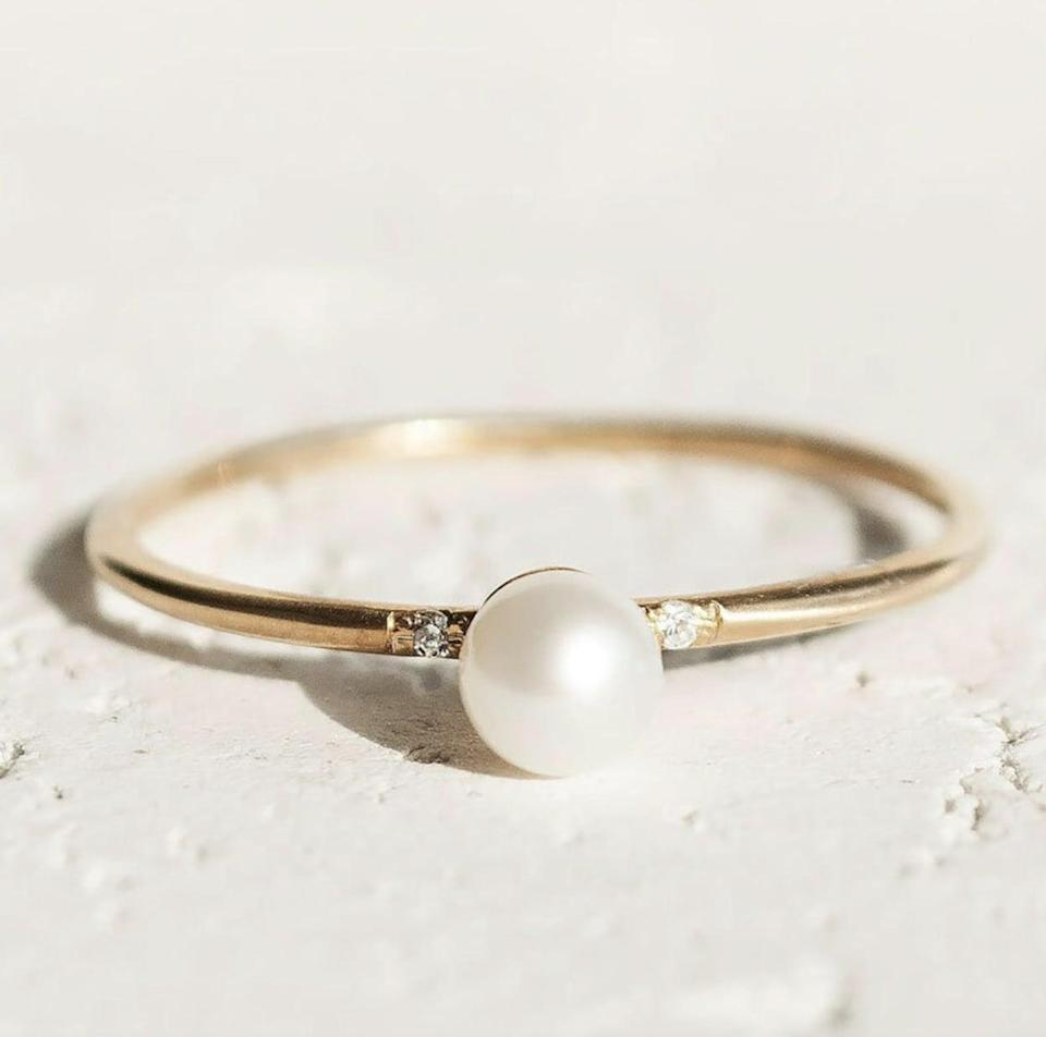 <p>We love the simple yet refined look of this <span>Pearl Engagement Ring</span> ($178).</p>