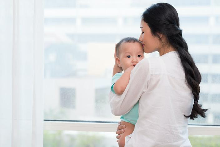 """<span class=""""caption"""">Better family leave policies would help women move into the workplace.</span> <span class=""""attribution""""><a class=""""link rapid-noclick-resp"""" href=""""https://www.shutterstock.com/image-photo/mother-kissing-her-little-baby-family-371032121?src=apBn1EcRO7pj9Qg_buUAfg-2-94"""" rel=""""nofollow noopener"""" target=""""_blank"""" data-ylk=""""slk:Dragon Images/Shutterstock.com"""">Dragon Images/Shutterstock.com</a></span>"""