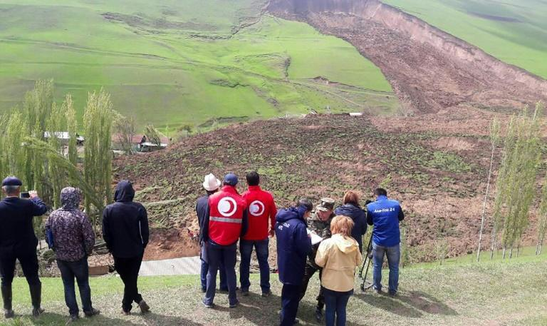A handout picture taken on April 29, 2017 and provided by the Kyrgyz Red Crescent Society press service shows a general view of the landslide-hit Ayu villge in Kyrgyzstan's Osh region