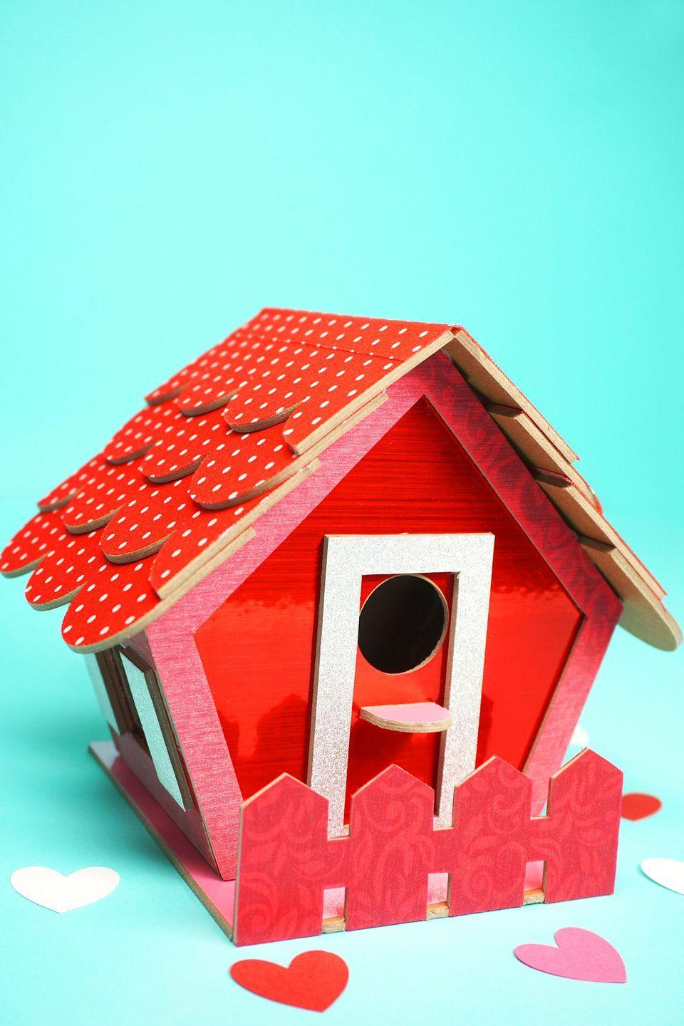 "<p>Put this bright red and pink birdhouse together with your kids. They'll definitely have the coolest Valentine box at school!</p><p><strong>Get the tutorial at <a href=""https://www.happinessishomemade.net/birdhouse-valentine-card-box/"" rel=""nofollow noopener"" target=""_blank"" data-ylk=""slk:Happiness Is Homemade"" class=""link rapid-noclick-resp"">Happiness Is Homemade</a>.</strong></p><p><a class=""link rapid-noclick-resp"" href=""https://www.amazon.com/Cricut-PC2004195-Maker-Champagne/dp/B072VYPWM4/?tag=syn-yahoo-20&ascsubtag=%5Bartid%7C10050.g.25844424%5Bsrc%7Cyahoo-us"" rel=""nofollow noopener"" target=""_blank"" data-ylk=""slk:SHOP CRICUT MAKERS"">SHOP CRICUT MAKERS</a></p>"