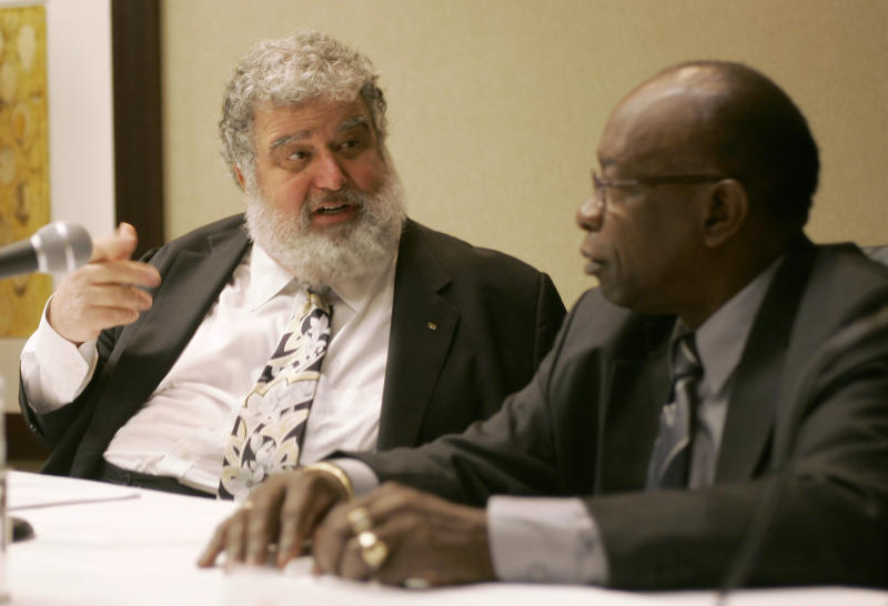 CORRECTS REPORT RELEASE DATE - FILE - In this Jan. 28, 2008 file photo, Confederation of North, Central American and Caribbean Association Football (CONCACAF) General Secretary Chuck Blazer, left, and President Jack Warner chat during a news conference, in Miami. A CONCACAF ethics and integrity committee have accused Warner and Blazer of enriching themselves with the regional soccer organization's money, in a 100-page report presented at the group's congress in Panama City, Friday, April 19, 2013, with FIFA President Joseph S. Blatter in attendance. (AP Photo/Wilfredo Lee, File)