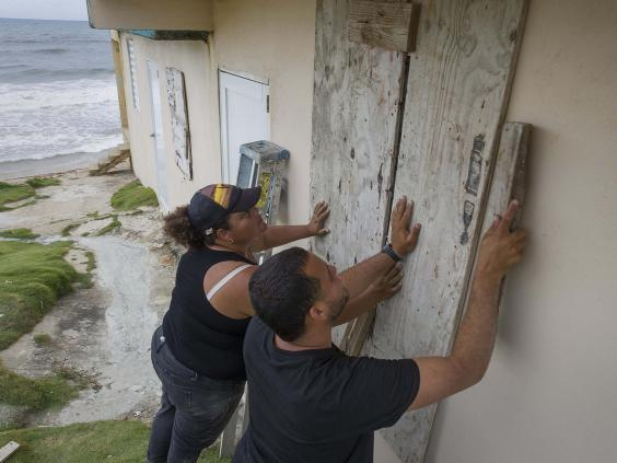 Puerto Rico residents board up their home ahead of Storm Dorian's arrival (Getty Images)