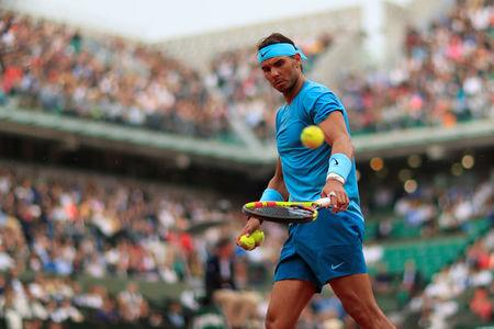 Rafael Nadal overcomes hiccup to march into French Open semi-finals