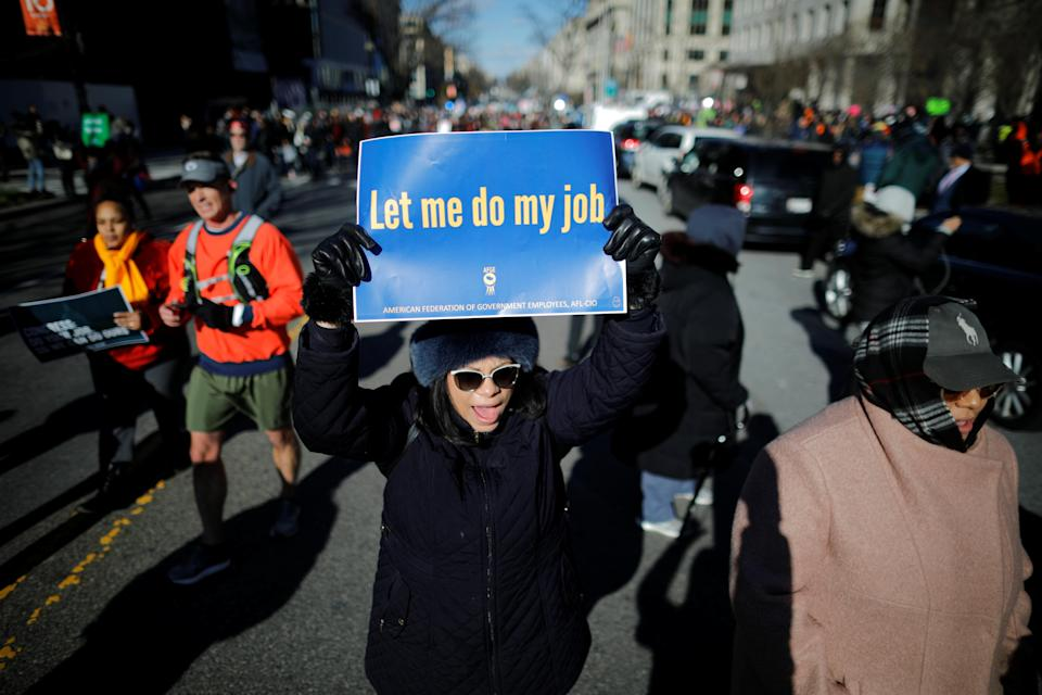 """Federal government employees, contract workers and other demonstrators march during a """"Rally to End the Shutdown"""" in Washington, D.C., Jan. 10, 2019. (Photo: Carlos Barria/Reuters)"""