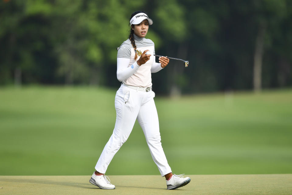 Patty Tavatanakit of Thailand holds the ball after finishing her play on the 18th hole during the final round of the LPGA Honda Thailand golf tournament in Pattaya, southern Thailand, Sunday, May 9, 2021. (AP Photo/Kittinun Rodsupan)