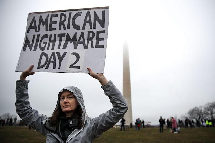 <p>A protestor, who identified herself as a 'U.S. Citizen from Seattle' holds up a sign near the Washington Monument during the Women's March on Washington January 21, 2017 in Washington, DC. (Drew Angerer/Getty Images) </p>