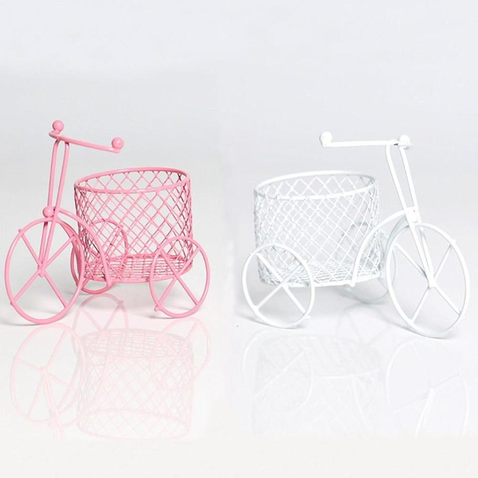 <p>Store your makeup sponges, makeup brushes, tools, lip products, mascaras, and more with these <span>Cute Bicycle Sponge and Makeup Brush Holder</span> ($15).</p>