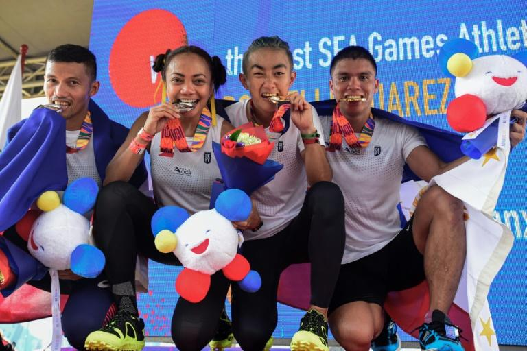 Philippines athletes show off their silver and gold medals following the obstacle course events at the SEA Games