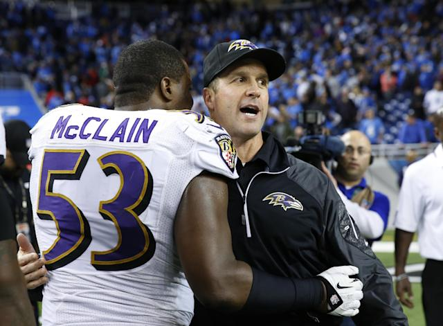 Baltimore Ravens head coach John Harbaugh hugs inside linebacker Jameel McClain after their 18-16 win over the Detroit Lions in an NFL football game in Detroit, Monday, Dec. 16, 2013. (AP Photo/Rick Osentoski)
