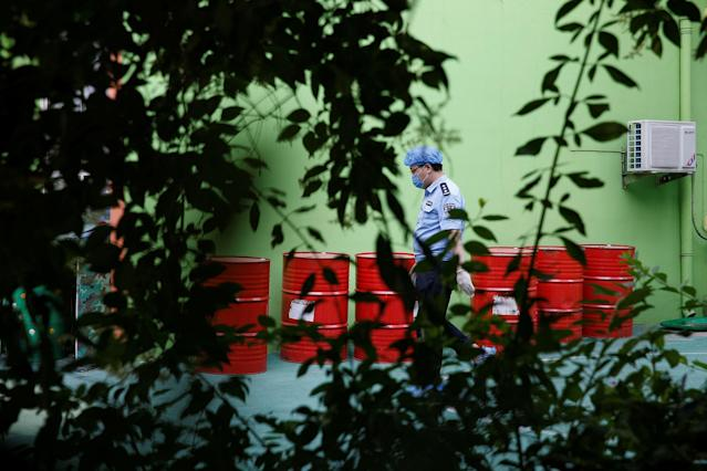 <p>A policeman walks at the scene of an explosion inside a kindergarten in Fengxian County in Jiangsu Province, China, June 16, 2017. (Photo: Aly Song/Reuters) </p>