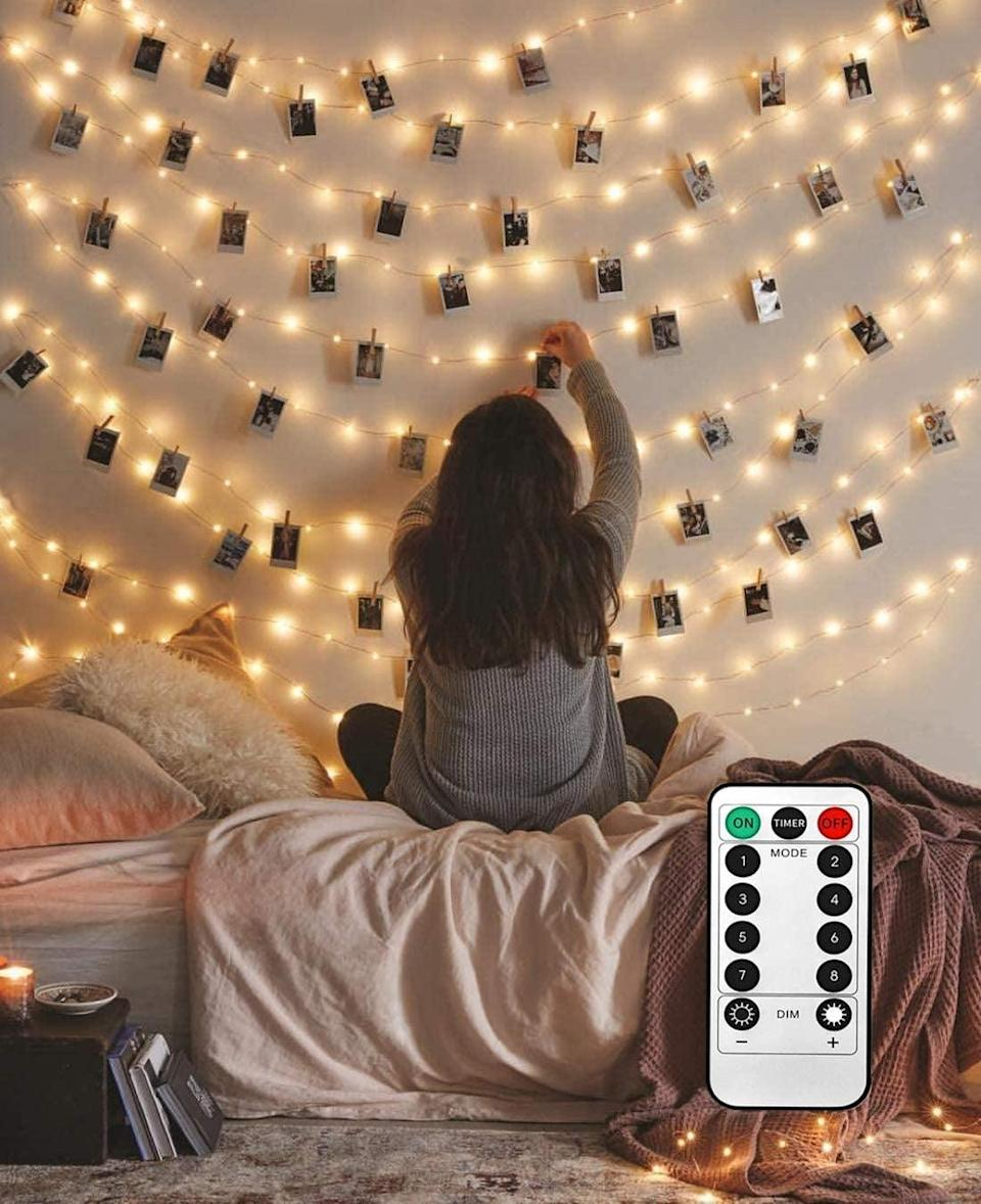 <p>They can decorate their room with the <span>8 Modes 40 LED Photo Clip String Lights With Remote</span> ($21, originally $23).</p>