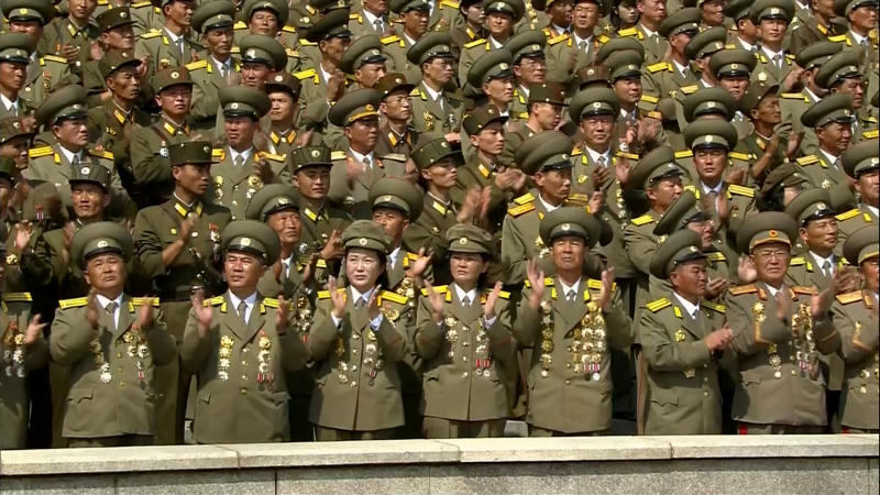 In this image taken from video North Korean military personnel watch a military parade marking the 65th anniversary of the country's founding, Monday, Sept. 9, 2013, in Pyongyang, North Korea. (AP Photo/KRT via AP Video) TV OUT, NORTH KOREA OUT