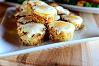 """<p>These portable potato-and-egg bites are perfect for a mess-free breakfast in bed. Serve them with fresh fruit and a side of bacon!</p><p><a href=""""https://www.thepioneerwoman.com/food-cooking/recipes/a10962/eggs-in-hash-brown-nests/"""" rel=""""nofollow noopener"""" target=""""_blank"""" data-ylk=""""slk:Get the recipe."""" class=""""link rapid-noclick-resp""""><strong>Get the recipe.</strong></a></p><p><a class=""""link rapid-noclick-resp"""" href=""""https://go.redirectingat.com?id=74968X1596630&url=https%3A%2F%2Fwww.walmart.com%2Fsearch%2F%3Fquery%3Dmuffin%2Bpans&sref=https%3A%2F%2Fwww.thepioneerwoman.com%2Ffood-cooking%2Frecipes%2Fg36145857%2Fbreakfast-in-bed-recipes%2F"""" rel=""""nofollow noopener"""" target=""""_blank"""" data-ylk=""""slk:SHOP MUFFIN PANS"""">SHOP MUFFIN PANS</a></p>"""