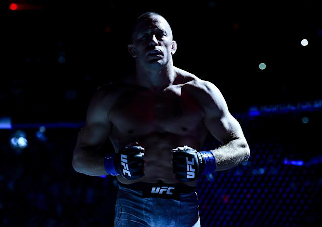 After he couldn't book a fight against former welterweight & middleweight champ Georges St. Pierre, Woodley decided to train with him in Montreal. (Getty Images)