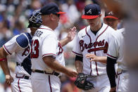Atlanta Braves manager Brian Snitker (43) relieves starting pitcher Tucker Davidson in the sixth inning of a baseball game against the Washington Nationals, Thursday, June 3, 2021, in Atlanta. (AP Photo/John Bazemore)