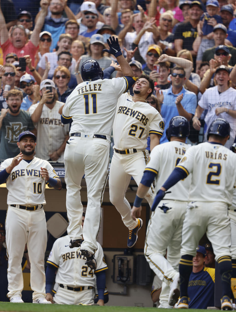 Milwaukee Brewers' Willy Adames (27) reacts with Rowdy Tellez (11) after his three-RBI pinch hit home run against the Pittsburgh Pirates during the seventh inning of a baseball game Wednesday, Aug. 4, 2021, in Milwaukee. (AP Photo/Jeffrey Phelps)