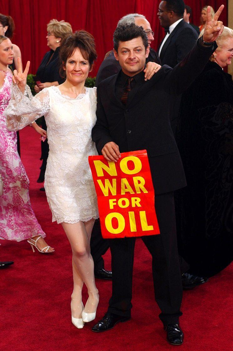 Actor Andy Serkis and his wife Lorraine Ashbourne protest the war with Iraq as they arrive for the 75th annual Academy Awards in 2003. (Photo: Kim D. Johnson/AP)<br>