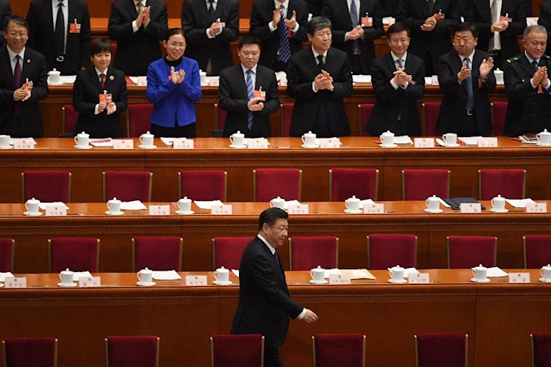 Chinese President Xi Jinping was applauded as he arrived for the key vote at the National People's Congress (AFP Photo/GREG BAKER)