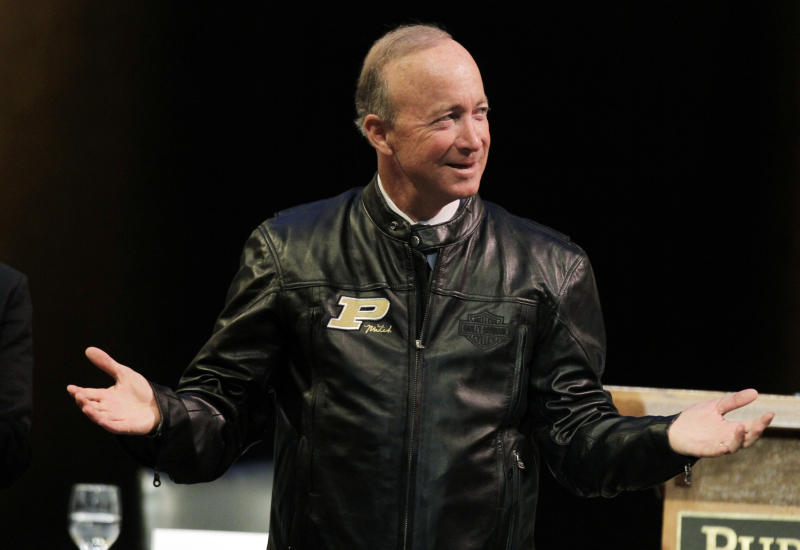 Indiana Gov. Mitch Daniels displays his new Purdue leather jacket given to him by the board of trustee after being named as the next president of Purdue University by the school's trustees in West Lafayette, Ind., Thursday, June 21, 2012. Daniels will take the helm of the school after leaving office in January and succeeds France Cordova who will leave in July after five years at Purdue's helm. (AP Photo/Michael Conroy)