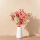 """Dress up a bare reading nook with <a href=""""https://www.glamour.com/gallery/best-flower-delivery-service?mbid=synd_yahoo_rss"""" rel=""""nofollow noopener"""" target=""""_blank"""" data-ylk=""""slk:this magical bouquet"""" class=""""link rapid-noclick-resp"""">this magical bouquet</a>, featuring multicolor gypsophila, sage green spear palms, and hot pink bunny tails. $99, The Bouqs. <a href=""""https://bouqs.com/flowers/dried/hot-pink-loofa-white-pink-gyp-ruscus-crespedia"""" rel=""""nofollow noopener"""" target=""""_blank"""" data-ylk=""""slk:Get it now!"""" class=""""link rapid-noclick-resp"""">Get it now!</a>"""