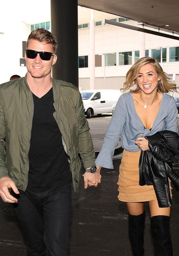 Richie and Alex were all smiles at Sydney airport after finally being able to go public. Photo: Matrix