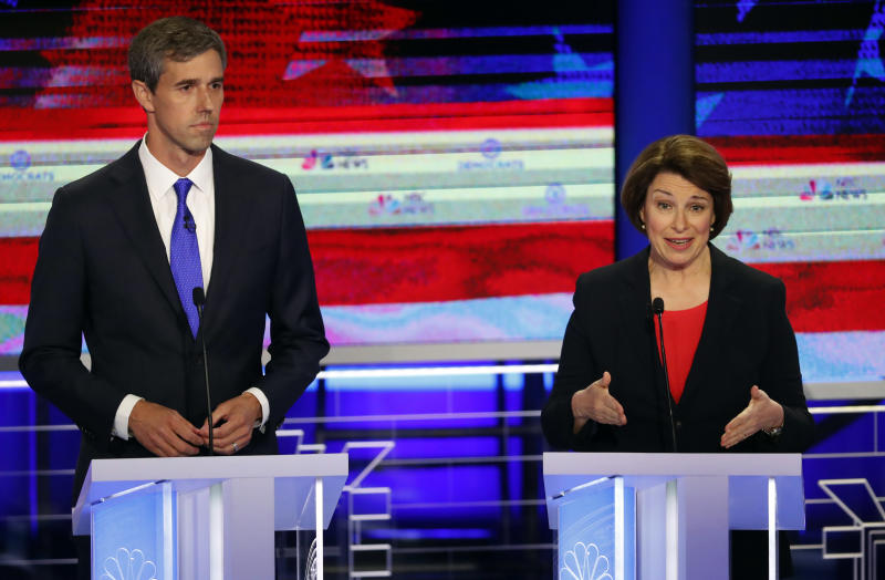 Democratic presidential candidate Sen. Amy Klobuchar, D-Minn., speaks at a Democratic primary debate hosted by NBC News at the Adrienne Arsht Center for the Performing Art, Wednesday, June 26, 2019, in Miami, as former Texas Rep. Beto O'Rourke listens. (AP Photo/Wilfredo Lee)