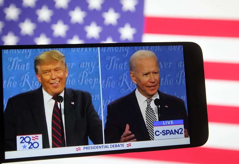 UKRAINE - 2020/09/30: In this photo illustration the US President Donald Trump and Democratic presidential candidate and former US Vice President Joe Biden are seen during the first presidential debate on a YouTube video displayed on a screen of a smartphone.  United States presidential election scheduled on November 3, 2020. (Photo Illustration by Pavlo Conchar/SOPA Images/LightRocket via Getty Images)