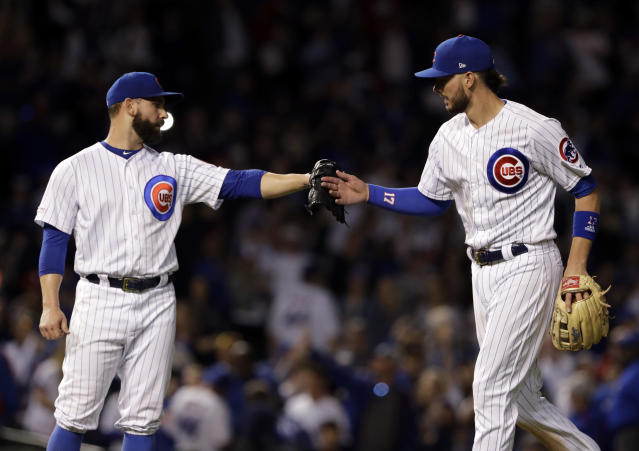 Chicago Cubs' Kris Bryant, right, celebrates with relief pitcher Tyler Chatwood after the Chicago Cubs defeated the St. Louis Cardinals 13-5 in a baseball game Sunday, May 5, 2019, in Chicago. (AP Photo/Nam Y. Huh)