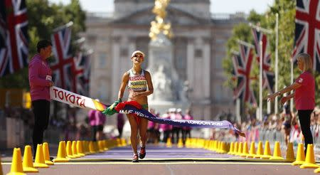 Athletics - World Athletics Championships – women's 50 km walk – London Stadium, London, Britain – August 13, 2017 – Ines Henriques of Portugal crosses the finish line to win the gold medal. REUTERS/Matthew Childs
