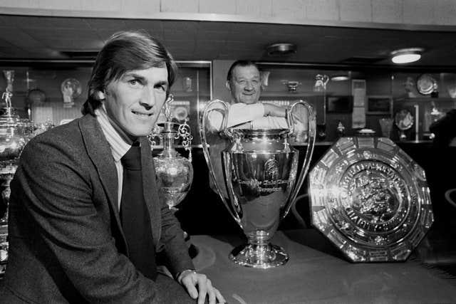Kenny Dalglish admires the silverware in the club's trophy room with manager Bob Paisley
