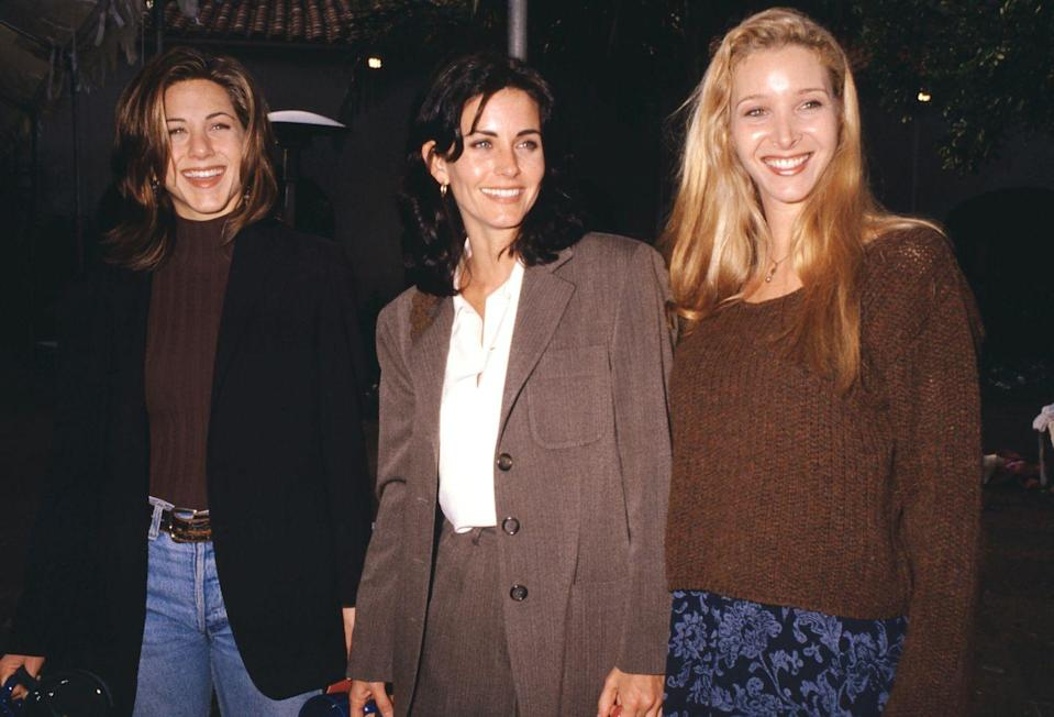 """<p><em>Friends </em>co-stars Jennifer Aniston, Courteney Cox, and Lisa Kudrow were the picture of '90s fall fashion. If there's anything to be learned, earth tones will always """"be there for you.""""</p>"""