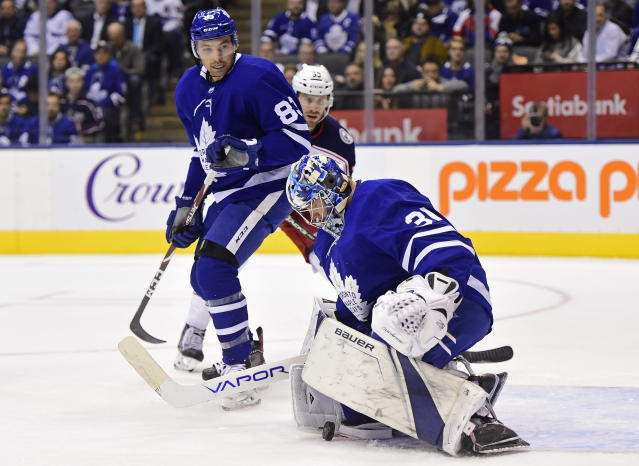 Toronto Maple Leafs goaltender Frederik Andersen (31) makes a save against the Columbus Blue Jackets as Maple Leafs defenseman Cody Ceci (83) looks on during first-period NHL hockey game action in Toronto, Monday, Oct. 21, 2019. (Frank Gunn/The Canadian Press via AP)