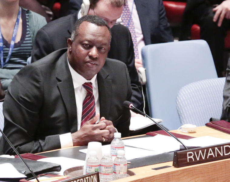 In this photo provided by the United Nations, Eugène-Richard Gasana, Permanent Representative of Rwanda to the UN, addresses the Security Council meeting at U.N. Headquarters, Wednesday, April 16, 2014, on the 1994 genocide in his country. During the session, former New Zealand ambassador Colin Keating, who was president of the Security Council in April 1994, apologized for the council's refusal to recognize that genocide was taking place in Rwanda and for doing nothing to halt the slaughter of more than one million people. (AP Photo/United Nations, Evan Schneider)