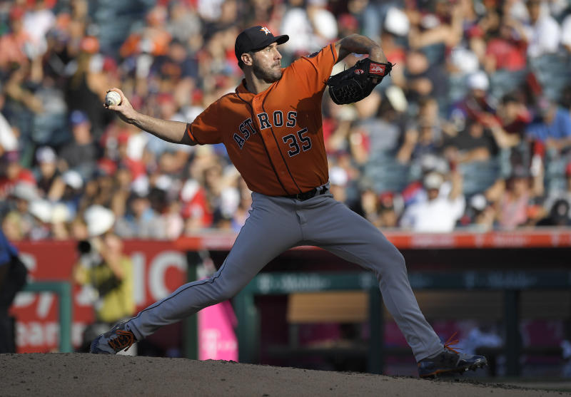 Houston Astros starting pitcher Justin Verlander throws to the plate during the fifth inning of a baseball game against the Los Angeles Angels, Saturday, July 21, 2018, in Anaheim, Calif. (AP Photo/Mark J. Terrill)