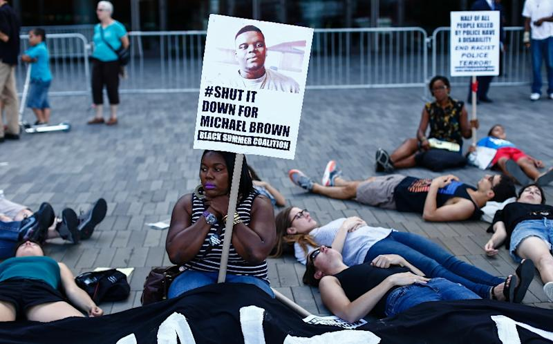 Demonstrators stage a die-in during a Michael Brown memorial protest in Brooklyn, New York, on August 9, 2015 (AFP Photo/Kena Betancur)