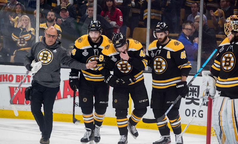 Bruins' Matt Grzelcyk taken to hospital after leaving Game 2 with injury