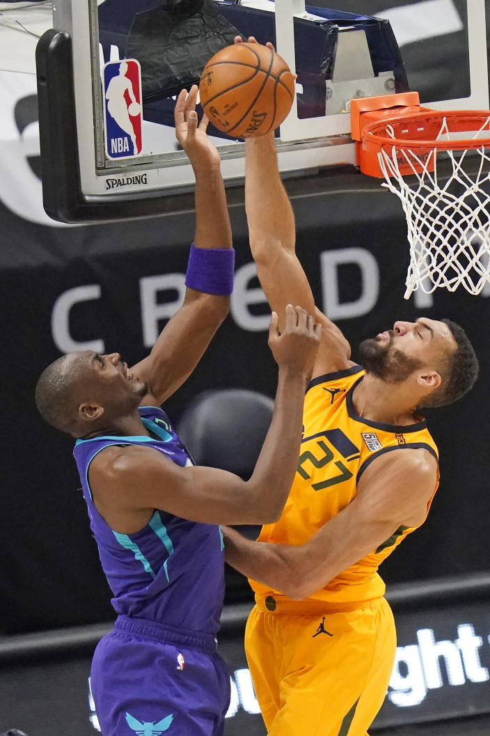Utah Jazz center Rudy Gobert (27) blocks the shot from Charlotte Hornets center Bismack Biyombo, left, in the first half during an NBA basketball game Monday, Feb. 22, 2021, in Salt Lake City. (AP Photo/Rick Bowmer)