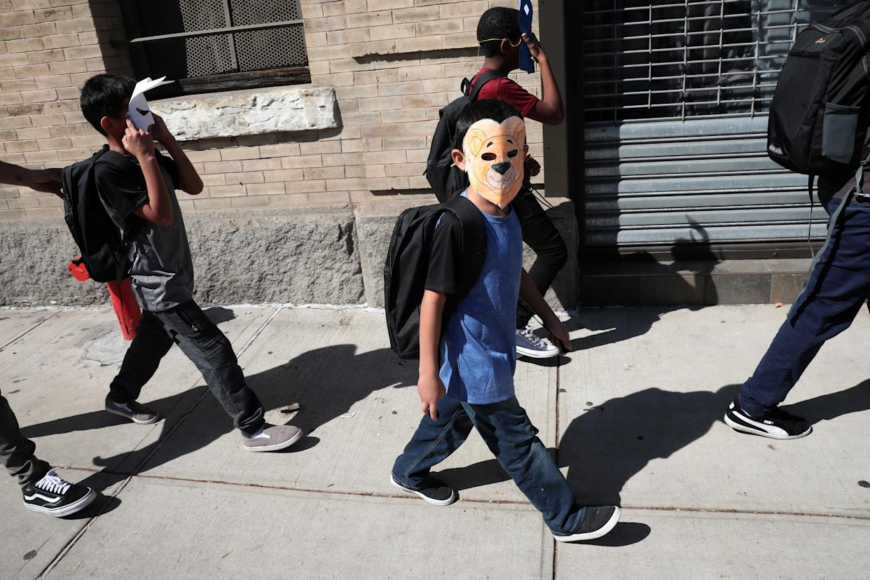 "<span class=""s1"">Children, with their faces covered with masks, leave the Cayuga Center in New York City, which provides foster care and other services to immigrant children separated from their families, on June 21. (Photo: Mike Segar/Reuters)</span>"