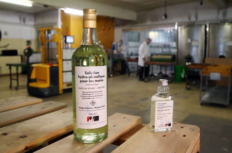 Bottles of pear and mint alcohol is pictured at Swiss distiller Morand in Martigny
