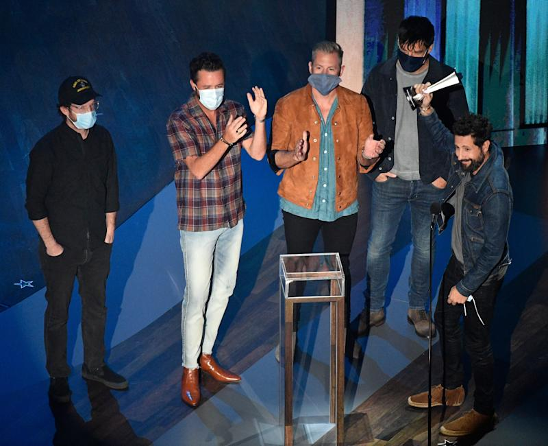 Matthew Ramsey, with his bandmates from Old Dominion, accepts the award for Group of the Year at the 55th Academy of Country Music Awards on Sept. 16, 2020.