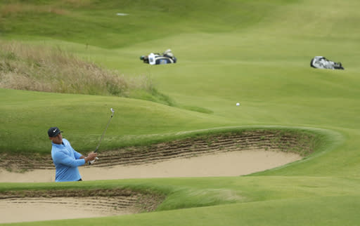 Brooks Koepka of the United States hits on the 14th green from a bunker during the third round of the British Open Golf Championships at Royal Portrush in Northern Ireland, Saturday, July 20, 2019.(AP Photo/Matt Dunham)
